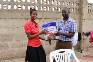 Health Project Coordinator Editha delivers mosquito nets for each child at Mwandaliwa Orphanage Centre
