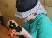 Nuru sews a pad at the Always Project