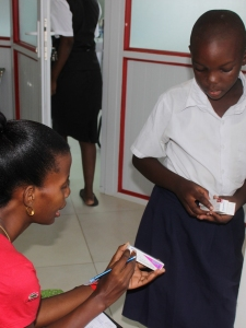 Our Health Project Coordinator helps a child with their new prescription.