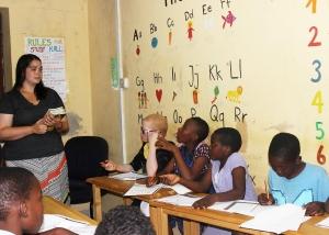 Teacher listening as kids pose questions.