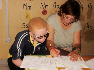 Teacher one-on-one analyzing work.