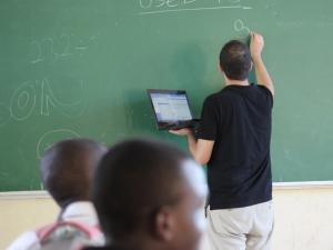 Francisco writes on the chalkboard