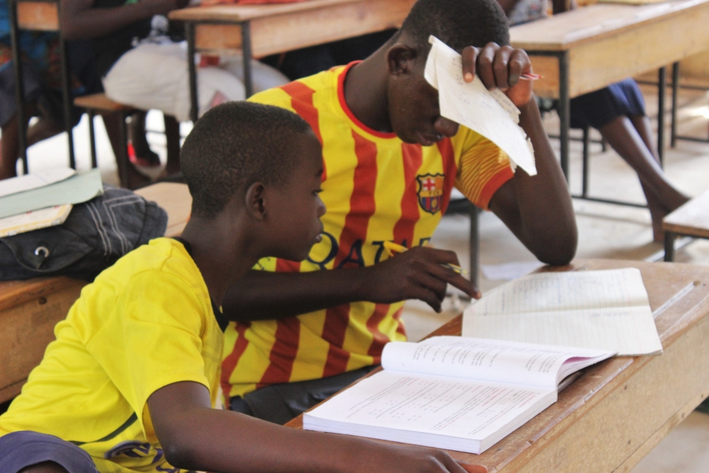 Boys working together on their studies