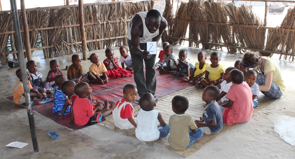 Dzinyeto, Kunduchi's local director and teacher, works hard with the children to learn basic math skills.